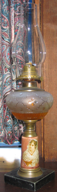 Old oil lamp with marble base